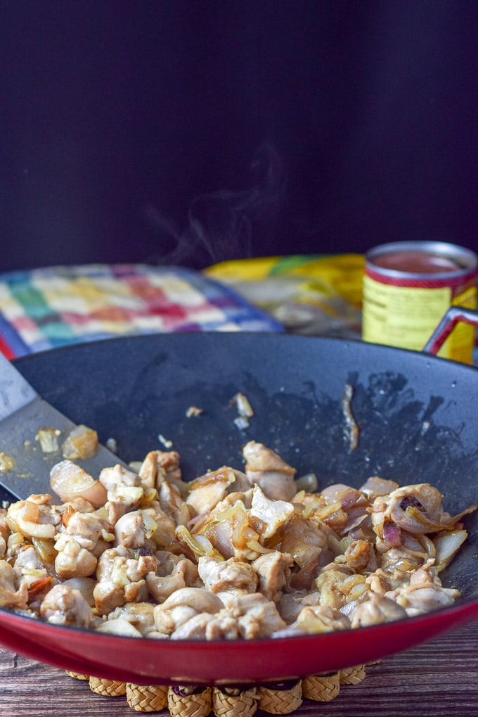 Sautéd shallots and chicken for the easy chicken enchiladas with white sauce