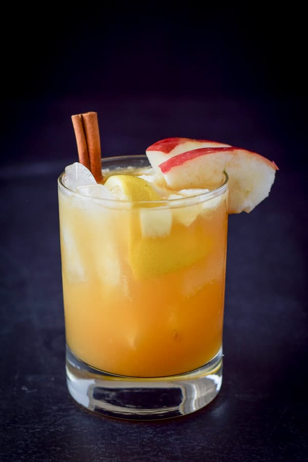 Beautiful view of the apple cider bourbon smash cocktail - gold and pretty