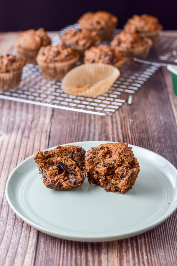One of the Delish date nut muffins broken in half and on a green plate