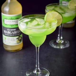 Two marvelous melon margarita cocktails poured in the glasses