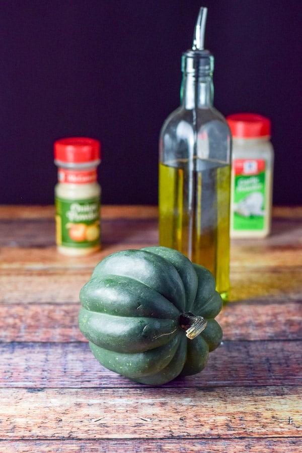 Acorn squash, olive oil, onion powder and garlic powder for the simple roasted acorn squash