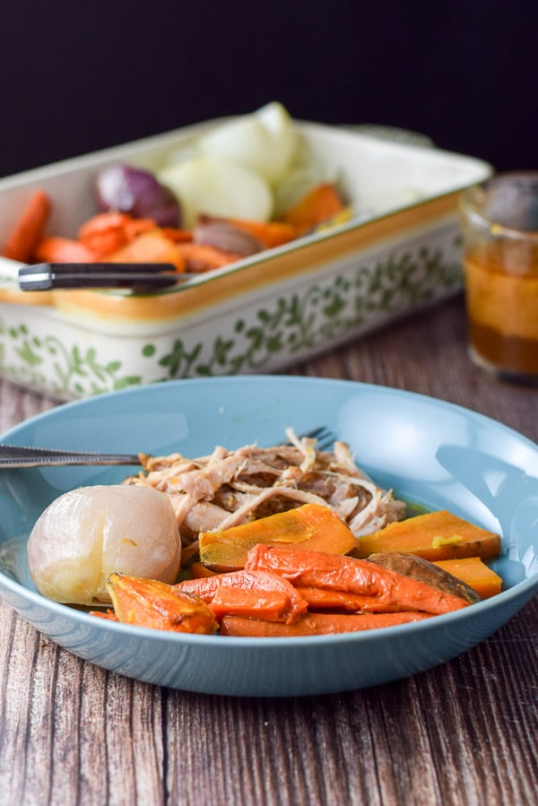simply delicious baked vegetables recipe plated with some pulled pork