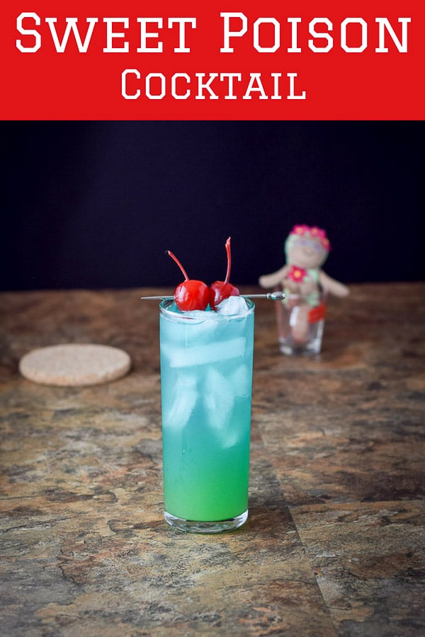 Aptly named sweet poison cocktail is dangerously delicious!  Two types of rum, blue Curacao and some pineapple juice in this tropical cocktail.  Make it by the glass unless you're with a group! #sweetpoison #cocktail #drinks #dishesdelish #dishesdelishrecipes https://ddel.co/swtpson