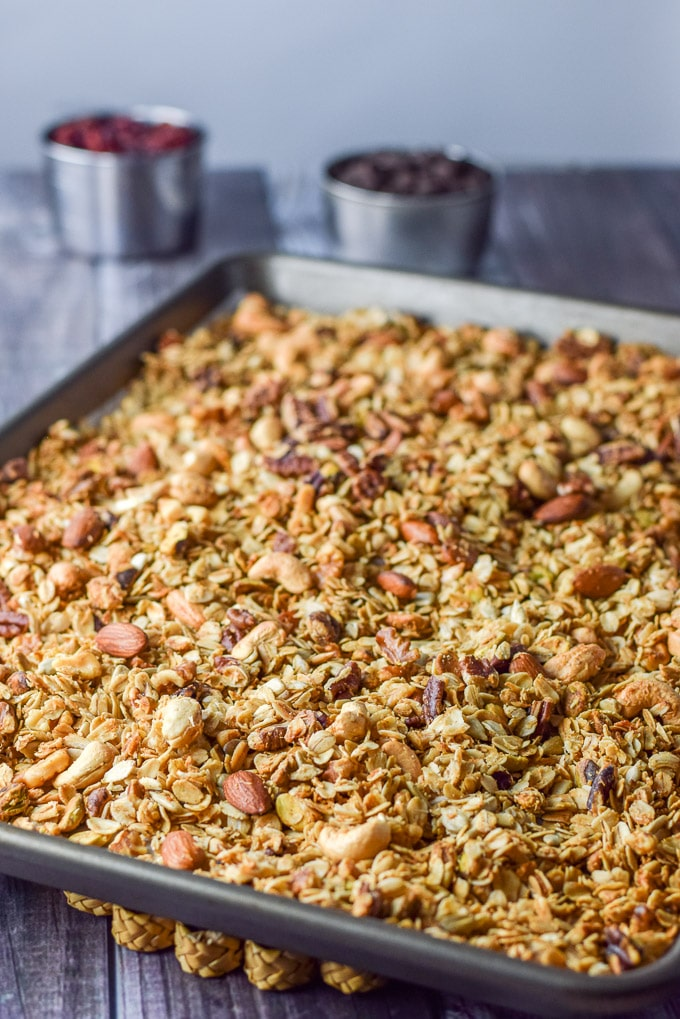 Cranberry chocolate granola baked and cooling on the table