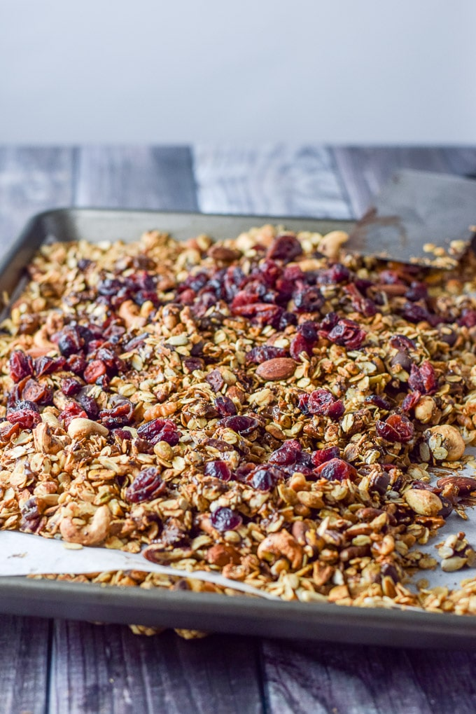 Chocolate mixed and cranberries on top of the cranberry chocolate granola