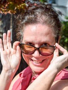 Elaine Benoit looking over her sunglasses