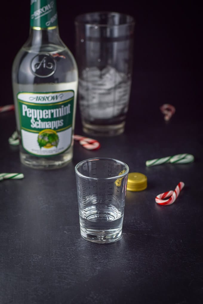 Peppermint schnapps poured out for the holiday chocolate candy cane martini