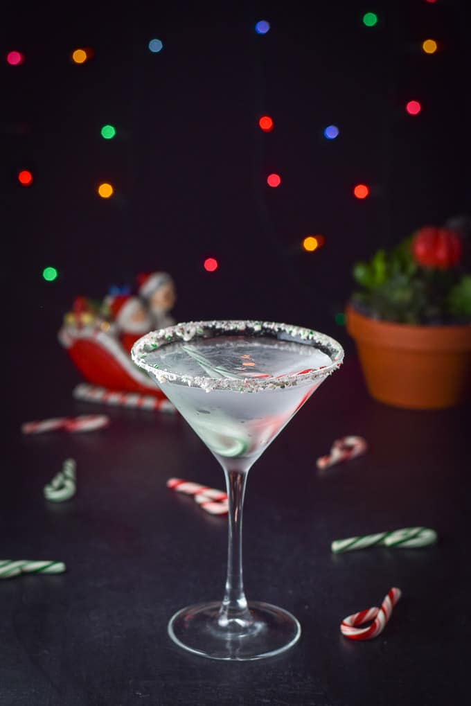 Poured holiday chocolate candy cane martini with santa and mrs clause in the background