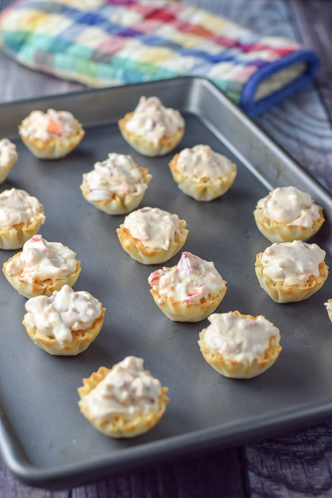 Filled phyllo tart shells with the cream cheese lobster mix for the phyllo cream cheese lobster appetizer
