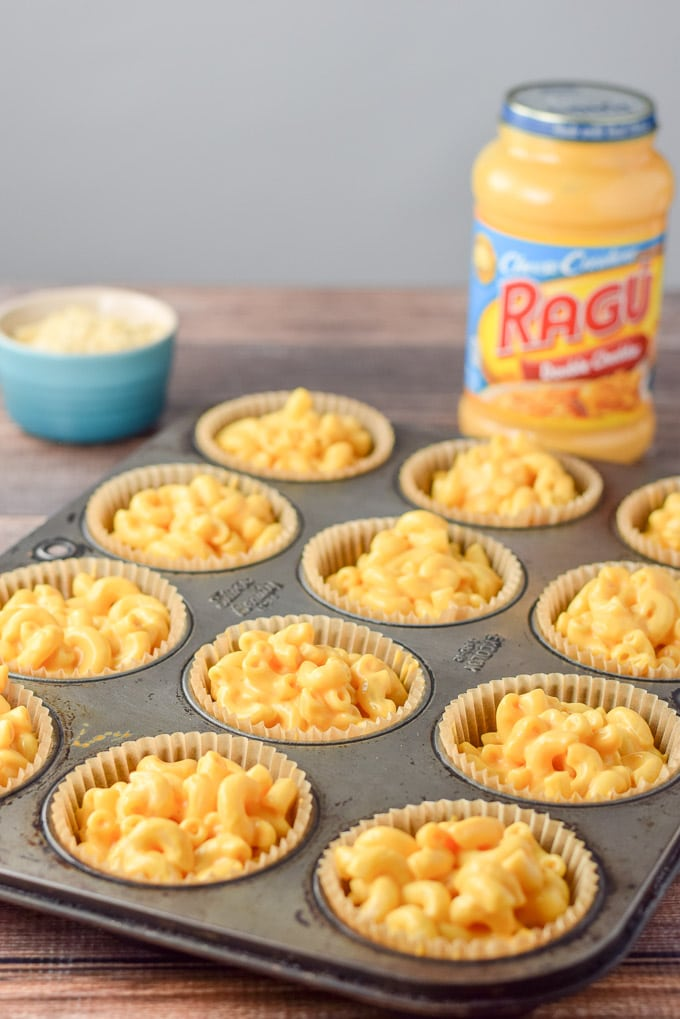 RAGÚ coated Elbow macaroni spooned into muffin cups for the easy baked mac and cheese cups
