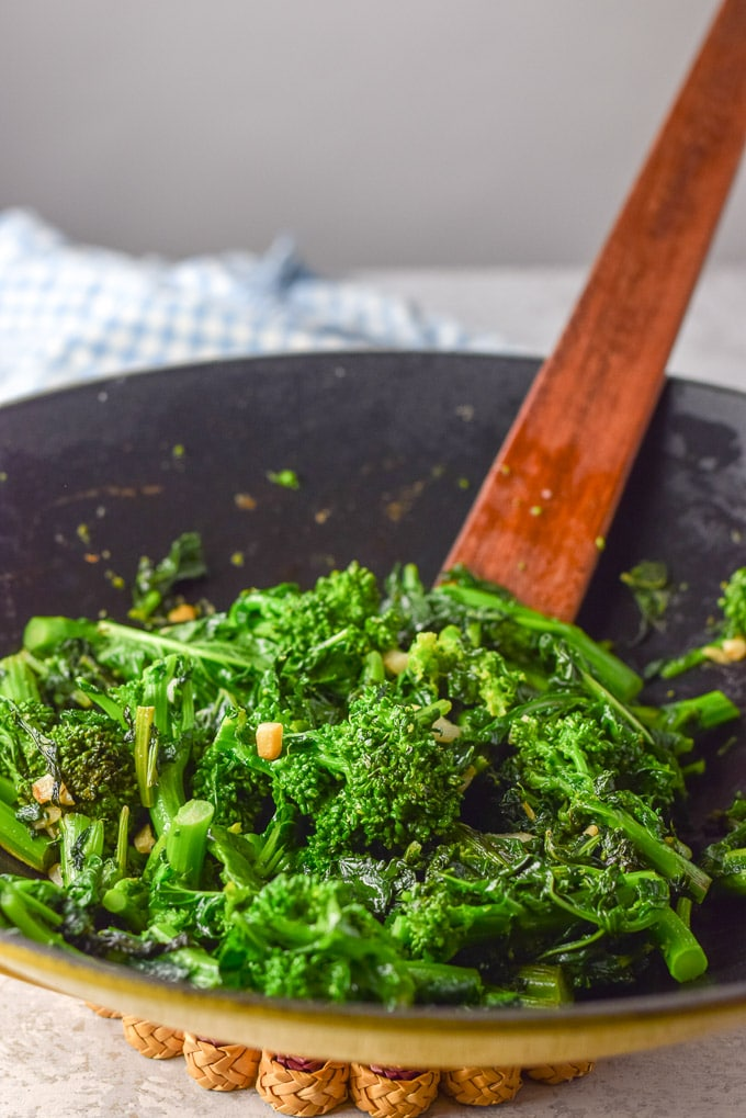 Cooked broccoli rabe in my yellow wok