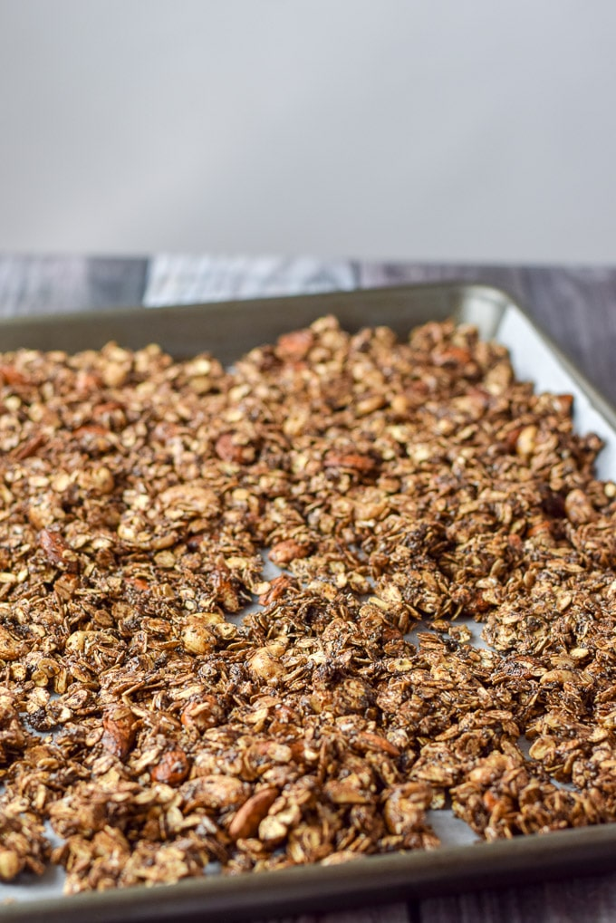 Raw chocolate peanut butter granola on a jelly roll pan