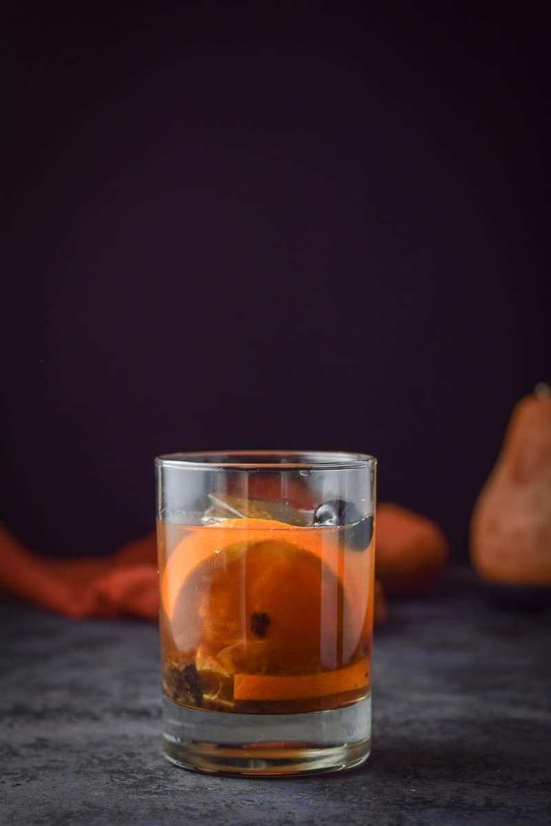 Vertical view of the classic old fashioned cocktail recipe