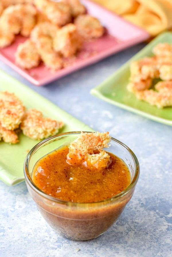 Baked coconut shrimp lying in the apricot dipping sauce