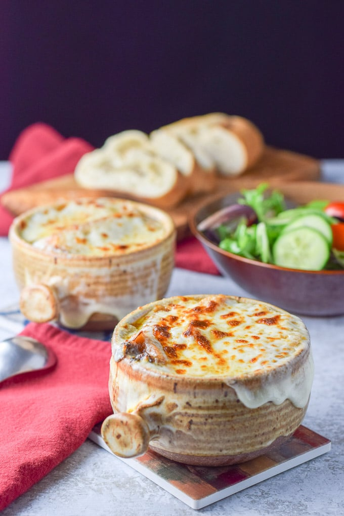 Cheese melted on the crocks of easy French onion soup