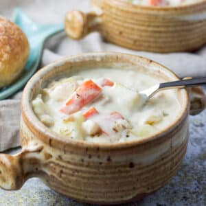 A crock filled with the easy clam chowder - square