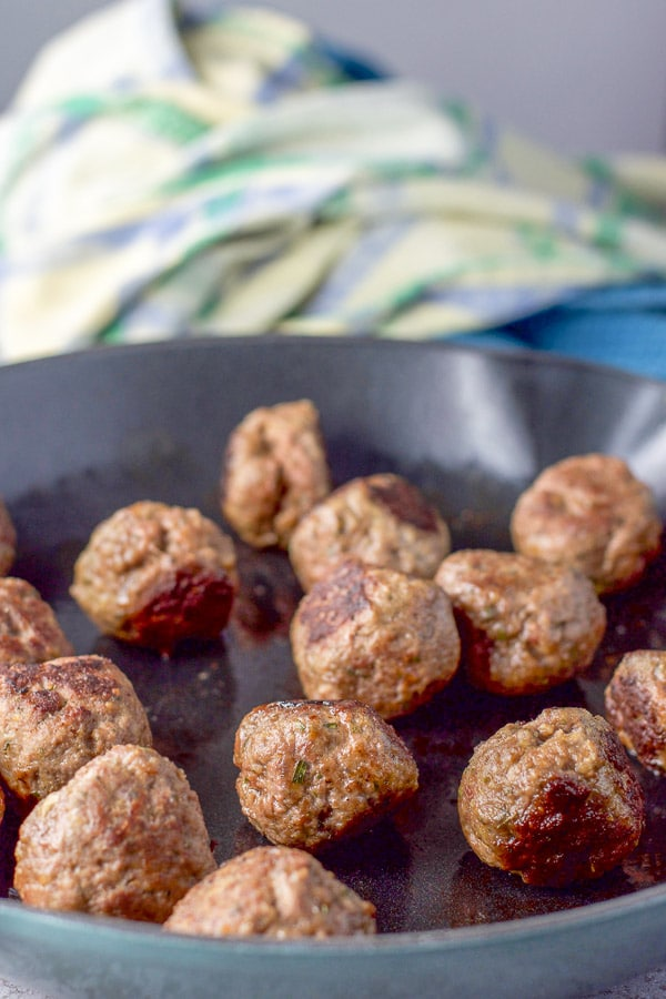 Meatballs cooked in a sauté pan for the Swedish meatballs with sour cream sauce