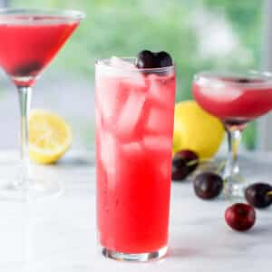 Collins glass in front for the cherry vodka sour - square