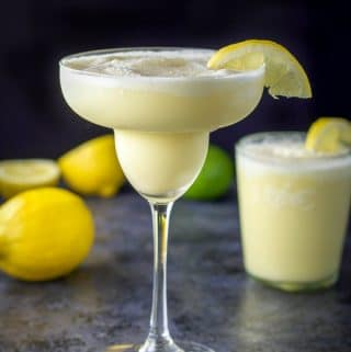 Tall margarita glass filled with lemon curd margarita