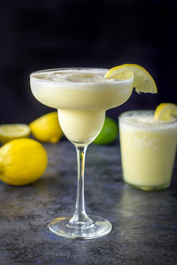 Tall margarita glass filled with lemon curd margarita