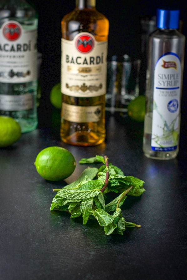 Mint leaves, limes, simple syrup and two kinds of wine for the mojito cocktail recipe