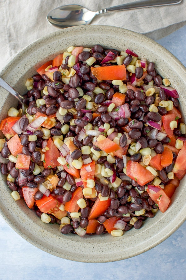 Overhead shot of the Close up of the Big serving bowl of black bean salad with corn