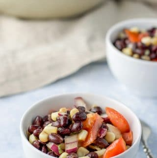 Close up of the Two single servings of the black bean salad with corn