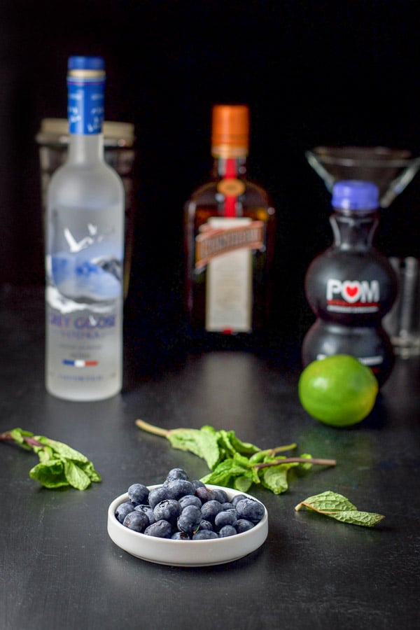 Blueberries, mint, vodka, Cointreau, lime, blueberry juice for the blueberry mint cosmo