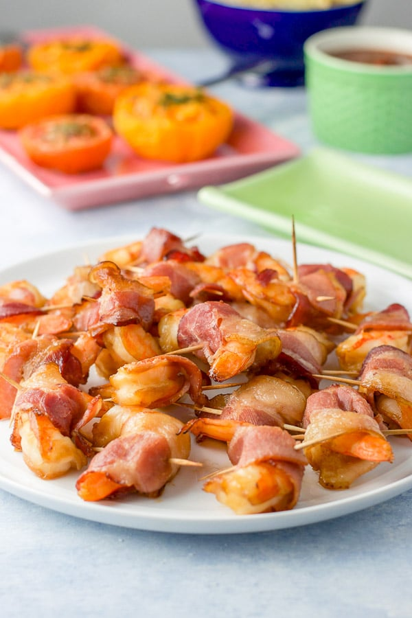 A plate of bacon wrapped shrimp ready to be consumed