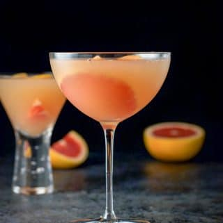 Vertical view of Different view of the Ruby red grapefruit cosmo poured into two martini glasses