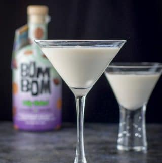 vertical view of the skinny Jane martini with bom bom bottle in the background