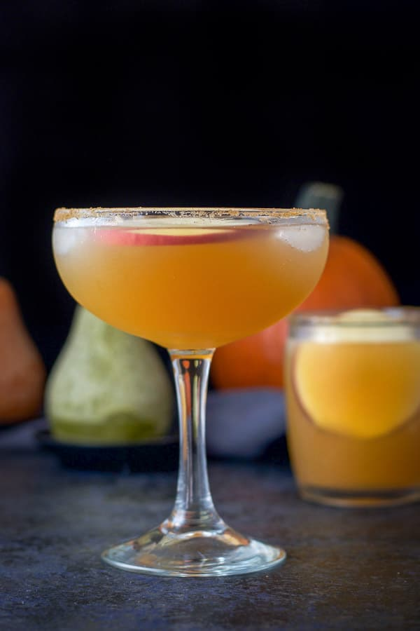 Vertical view of the tall bowl shaped glass filled with the apple cider margarita