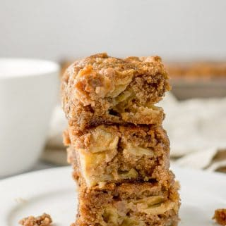 A stack of apple walnut cake with crumbs all around