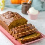 Easy pumpkin bread sliced and presented on a pink plate