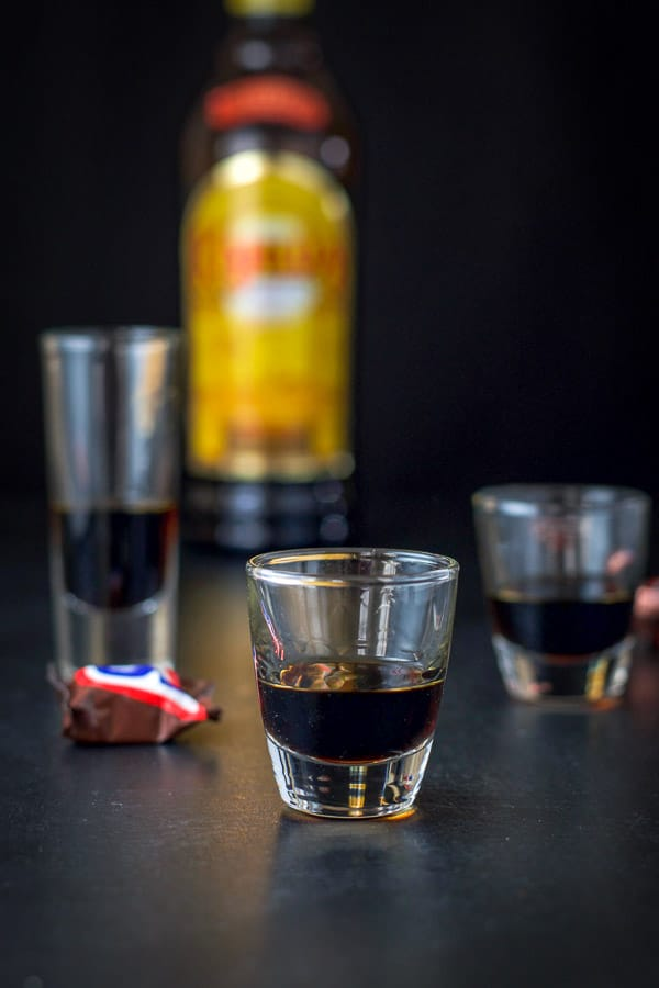 Kahlúa poured out in the three glasses for the snickers shot