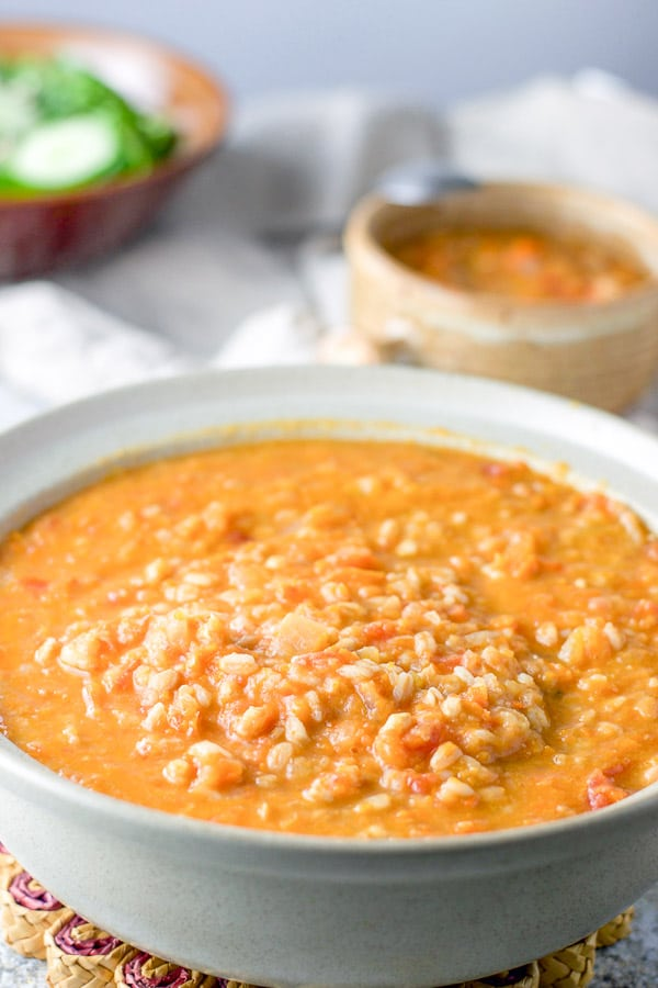 Farro cooked and the Tuscan white bean soup is in a serving bowl