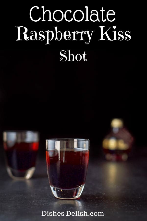 This chocolate raspberry kiss shot only has two ingredients and is so delicious you will have to watch out since it goes down smoothly!  #kahlua #chambord #shot #dishesdelish