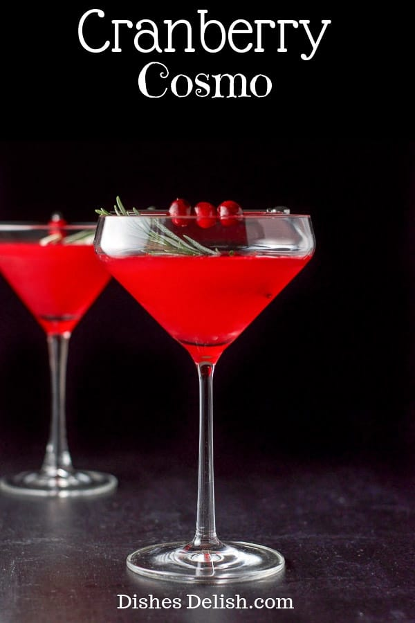 This beautiful and festive cranberry cosmo has only three ingredients!  The vibrant color comes from the cranberry infused vodka not added cranberry juice!  Perfect for the holiday season! #cranberry #vodka #cosmo #cocktail #dishesdelish