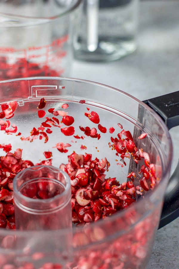 Chopped up cranberries in a food processor for the cranberry infused vodka