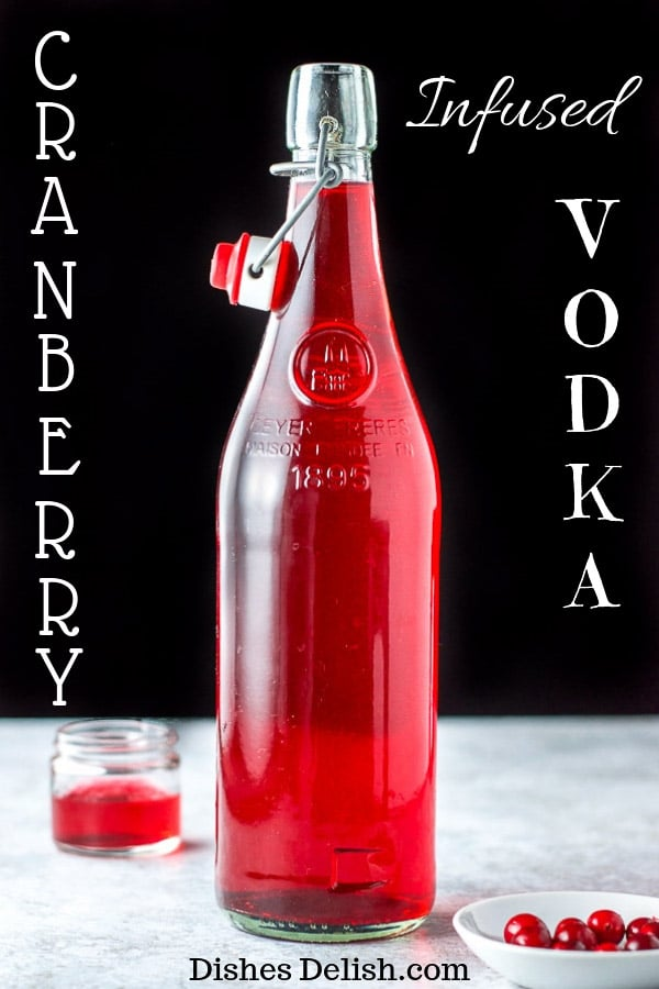 This cranberry infused vodka is delightfully tart!  There is no added sugar because I believe it should be added to the cocktail and not the vodka!!  It's vibrant and delicious! #vodka #cranberry #cranberryvodka #dishesdelish
