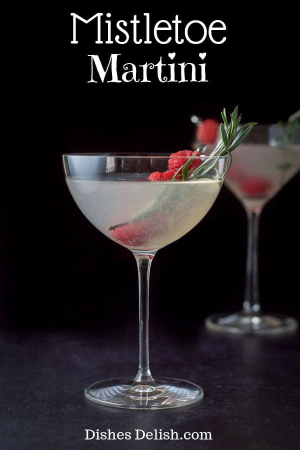 The combination of vodka, cherry brandy with the sweet and sour flavors gives this mistletoe martini a special taste that continues to satisfy with each sip. Some cocktails are made prettier by the garnish and this is one of them! #martini #cocktail #drink #dishesdelish