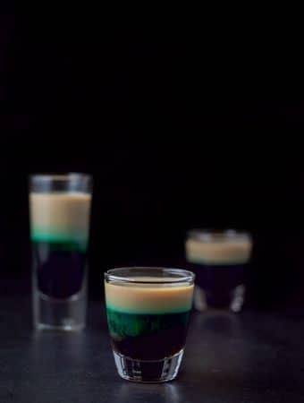 Another view of the short glass showing the green leeching in the Baileys for the after eight shot