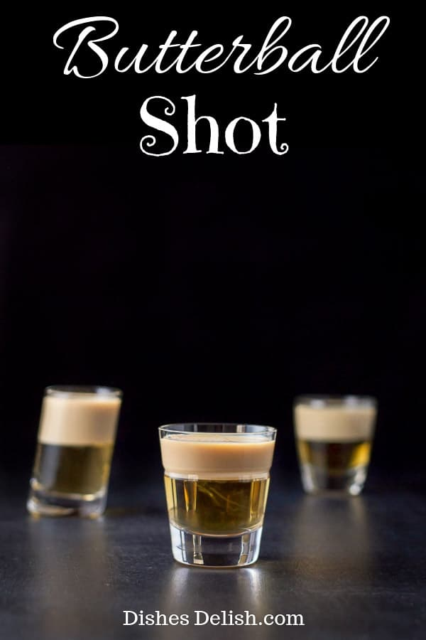 There are only two ingredients to this delicious and pretty shot!  The combination of butterscotch schnapps and Baileys make you think of butter rum candies or even what you imagine butter beer would taste like! #butterballshot #layeredshot #dishesdelish