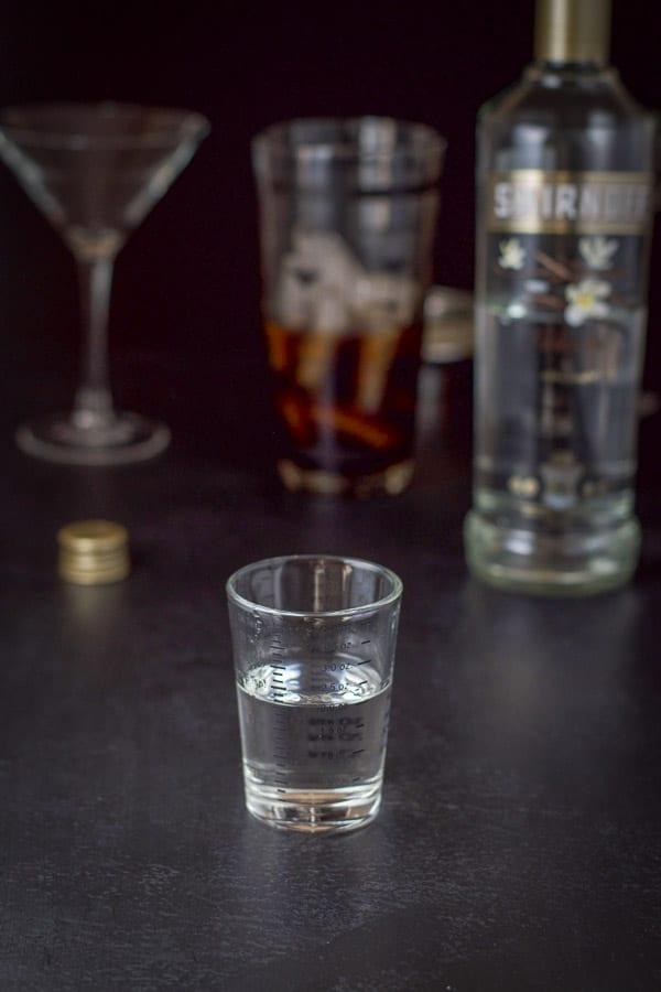 Vanilla vodka poured for the chocolate eggnog martini
