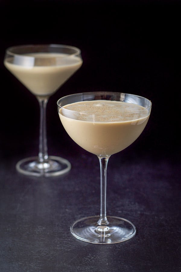 The chocolate eggnog martini poured in the glasses