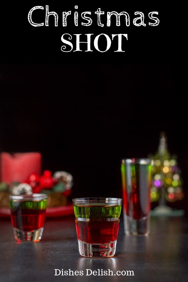 There are only two ingredients to this gorgeous and delicious Christmas shot!  It's sweet, stunning and a fun shot to serve at your holiday party! #midori #christmasshot #layeredshot #dishesdelish