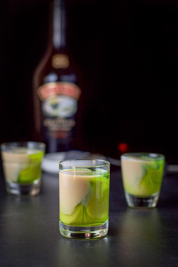 Baileys layered into the glasses for the mangled frog shot