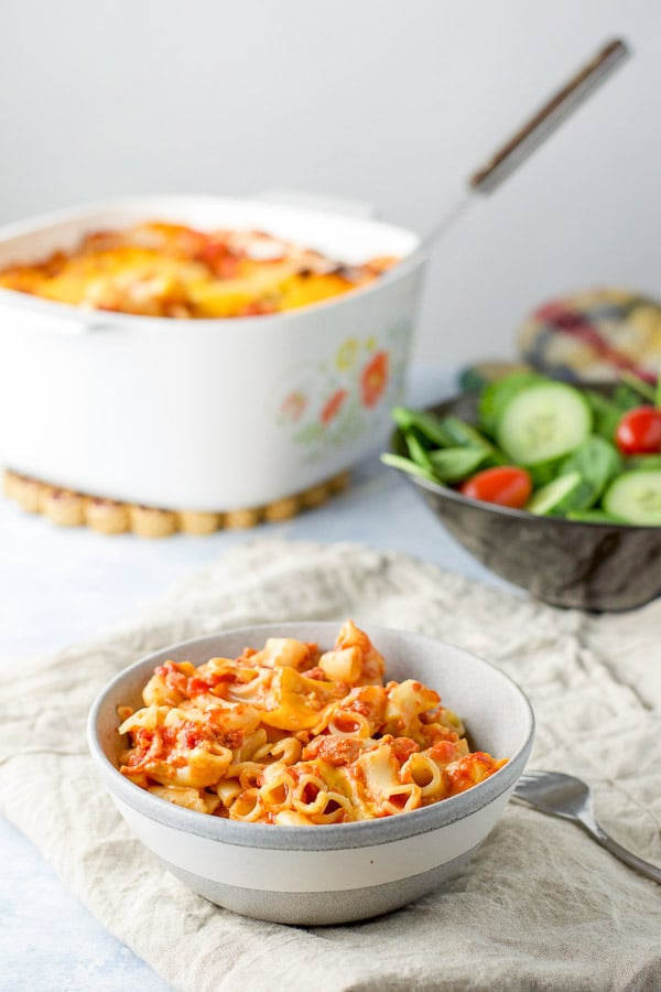 another view of the bacon tomato pasta with the casserole dish in the background