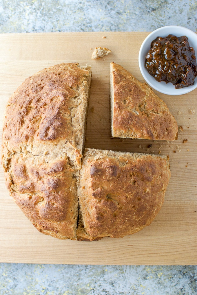 Overhead shot of the loaf of brown Irish soda bread cut in fourths
