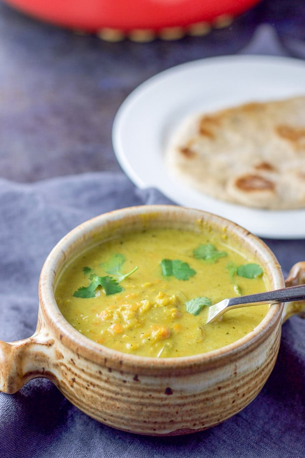 A close up view of the coconut curry lentil soup in a bowl